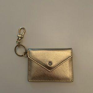 White House Black Market gold card case NEW